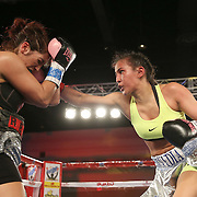 Nydia Feliciano (R) throws a right hand against Noemi Bosques during a Telemundo Boxeo boxing match at the A La Carte Pavilion on Friday,  March 13, 2015 in Tampa, Florida.  Feliciano won the bout by split decision. (AP Photo/Alex Menendez)