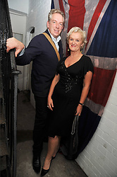 KITTY ARDEN and MICHAEL HOWELLS at the opening of his pop up shop at 35 South Audley Street, London W1 on 19th September 2009.