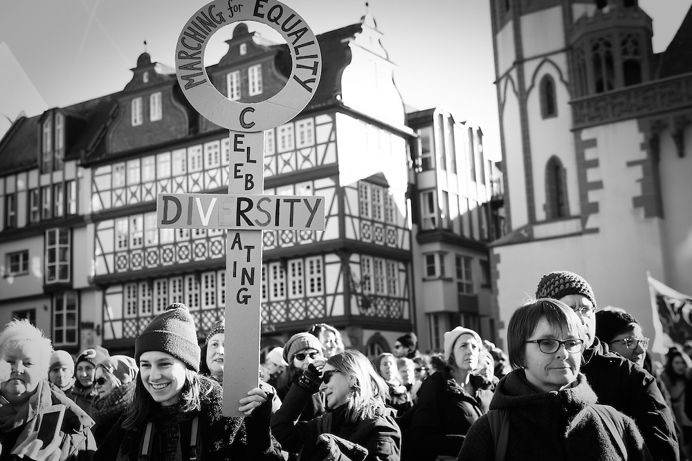 """The Women's March Frankfurt on January 21, 2017 was attended by over 2,100 people.  Photographer Jenny Mayfield captured the organizers, volunteers and participants as they marched from the Alter Oper to the Römer.  The collective chant was """"Gemeinsam Stark."""""""