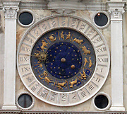 The Clockface of St Mark's Clocktower 2013. Blue and Gold clock face lined with the signs of the Zodiac and Roman Numerals.