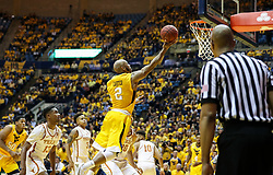Jan 20, 2018; Morgantown, WV, USA; West Virginia Mountaineers guard Jevon Carter (2) shoots a layup during the second half against the Texas Longhorns at WVU Coliseum. Mandatory Credit: Ben Queen-USA TODAY Sports
