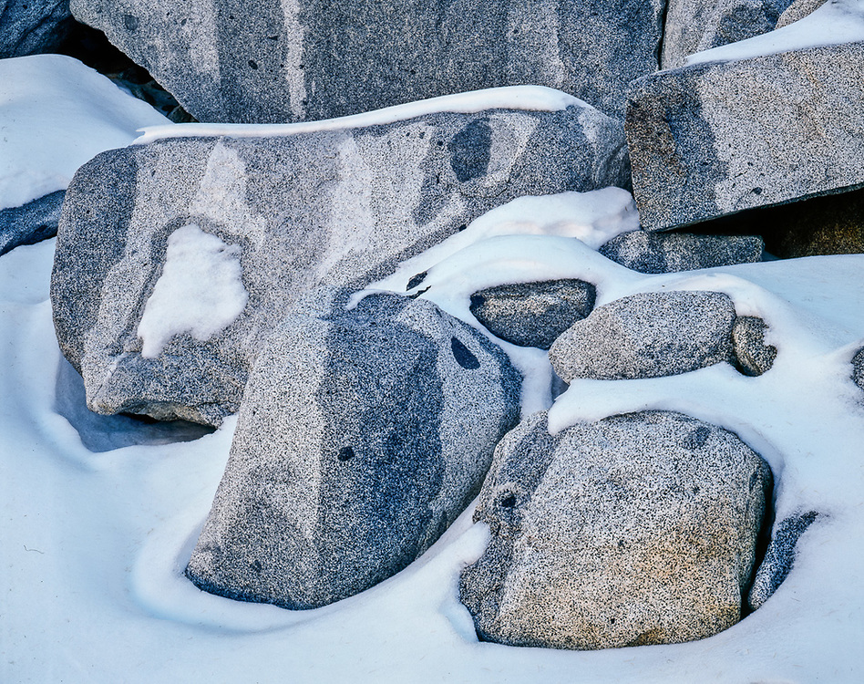 Granite boulders and snow, October, Upper Enchantments, Alpine Lakes Wilderness, Cascade Mountains,  Washington, USA