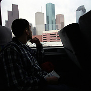 11/15/02<br />Angel checks out the Houston skyline as the bus nears the station where he would have several hours layover before catching his second bus that would take him home.