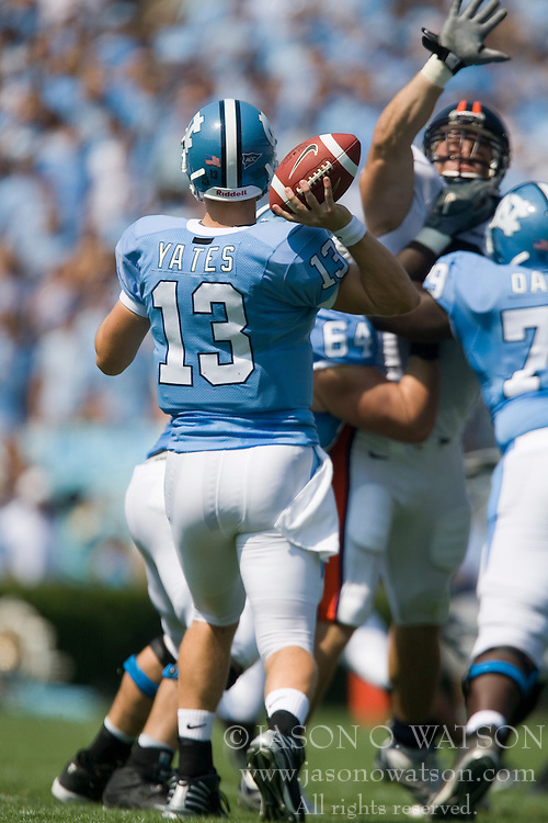 Virginia defensive end Chris Long (91) leaps over the UNC offensive line to block a North Carolina quarterback T.J. Yates (13) pass.  The North Carolina Tar Heels football team faced the Virginia Cavaliers at Kenan Memorial Stadium in Chapel Hill, NC on September 15, 2007.  UVA defeated UNC 22-20.