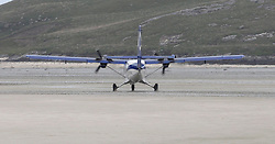 Barra Airport is a short-runway airport situated in the wide shallow bay of Traigh Mhòr at the north tip of the island of Barra in the Outer Hebrides, Scotland. Barra is now the only beach airport anywhere in the world to be used for scheduled airline services. Loganair Twin Otter taxiing for take off. (c) Stephen Lawson   Edinburgh Elite media