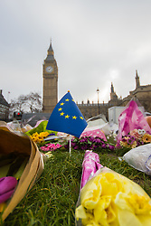 Westminster, London, March 27th 2017. A EU flag planted among the many floral tributes in Westminster, caches the early morning breeze. CREDIT: ©Paul Davey<br /> <br /> ©Paul Davey<br /> FOR LICENCING CONTACT: Paul Davey +44 (0) 7966 016 296 paul@pauldaveycreative.co.uk