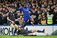 Sheffield Wednesday midfielder Barry Bannan (10)  slide tackles Chelsea Midfielder Callum Hudson-Odoi during the The FA Cup fourth round match between Chelsea and Sheffield Wednesday at Stamford Bridge, London, England on 27 January 2019.