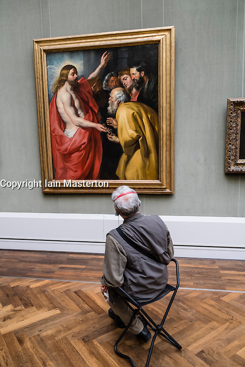 Visitors looking at paintings at Gemaldegalerie art museum at Kulturforum in Berlin Germany