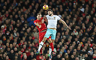 Ragnar Klavan of Liverpool and Andy Carroll of West Ham United during the Premier League match at Anfield Stadium, Liverpool. Picture date: December 11th, 2016.Photo credit should read: Lynne Cameron/Sportimage