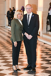 French President's wife Brigitte Macron welcomes Norwegian Prime Minister's husband Sindre Finnes as they take part in a spousal event at the Chateau de Versailles in Versailles, near Paris, on November 11, 2018 as part of commemorations marking the 100th anniversary of the 11 November 1918 armistice, ending World War I. Photo By Laurent Zabulon/ABACAPRESS.COM