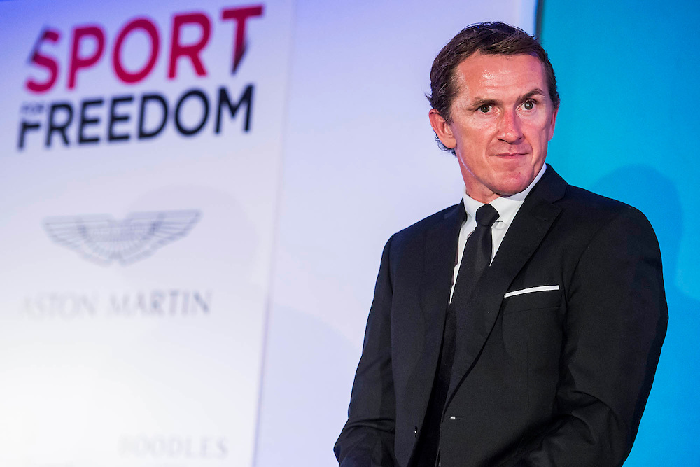 AP McCoy OBE - UK charity, Sport for Freedom (SFF), marks Anti-Slavery Day 2015 by hosting a charity Gala Dinner, supported by Aston Martin, on Thursday 15th October at Stamford Bridge, home of Chelsea Football Club. This inaugural event brought together people from the world of sport, entertainment, media, and business to unite behind a promise to tackle the issue of modern day human trafficking and slavery.  <br /> Hosted by Sky presenters Sarah-Jane Mee and Jim White, the Sport for Freedom Gala Dinner includes guests such as jockey AP McCoy OBE; Denise Lewis, former British Olympic Gold Medal winner; BBC Strictly star, Brendan Cole; Al Bangura, former Watford FC player and Sport for Freedom Ambassador who was trafficked from Africa to the UK at the age of just 14yrs old; Made in Chelsea star, Ollie Proudlock; ITV weather presenter, Lucy Verasamy; Sky Sports F1 presenter and SFF Ambassador, Natalie Pinkham; Premier League footballers Ryan Bertrand of Southampton FC and Troy Deeney of Watford FC and champion boxer, Anthony Joshua; and The UK's first independent Anti Slavery Commissioner, Kevin Hyland OBE, who highlighted the issues of modern day slavery that face the UK and world today. <br /> The evening concluded with chart topping music from 'Naughty Boy'. <br /> Sport for Freedom are also joining forces with the Premier League Academies for an international  'Football for Freedom' tournament with their U16's players that will also involve educating those taking part about the issues surrounding modern day slavery. The final will take place at Liverpool FC's Academy on Anti-Slavery Day, 18th October.