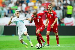 Kevin Kampl of Slovenia vs Fabian Delph of England during the EURO 2016 Qualifier Group E match between Slovenia and England at SRC Stozice on June 14, 2015 in Ljubljana, Slovenia. Photo by Vid Ponikvar / Sportida