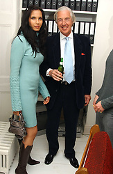 PADMA LAKSHMI wife of Salman Rushdie and MARTIN SUMMERS at a private view of an exhibition of photographs by the late Robert Mapplethorpe curated by artist David Hockney at the Alison Jacques Gallery, 4 Clifford Street, London W1 on 13th January 2005.<br />