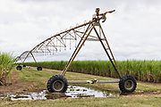 Mobile lateral move irrigation boom system in field of sugar cane in Bundaberg, Queensland, Australia. <br />