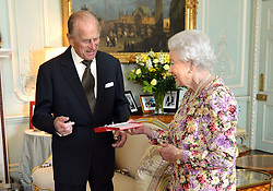 Queen Elizabeth II presents the Duke of Edinburgh with New Zealand's highest honour, the Order of New Zealand at Buckingham Palace, London.