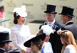 The Duchess of Cambridge with Mike Tindall (centre) during day one of Royal Ascot at Ascot Racecourse.