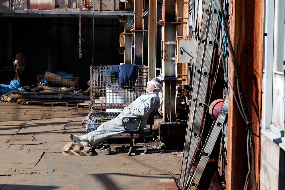 metal shop worker taking a lunch break nap Yokosuka Japan