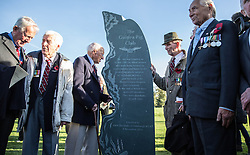 """Surviving members of the RAF's """"Guinea pig club"""" stand next to their newly unveiled memorial that was unveiled by The Duke of Edinburgh, President, the Guinea Pig Club at the National Memorial Arboretum, Staffordshire."""