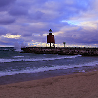 """""""Charlevoix Lighthouse Sunset"""" 1<br /> <br />  The beautiful red lighthouse in Charlevoix Michigan during a storm at sunset with waves breaking against the pier!!<br /> <br /> Lighthouses of the Great Lakes by Rachel Cohen"""