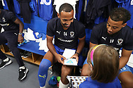 AFC Wimbledon midfielder Liam Trotter (14), Mascot during the EFL Sky Bet League 1 match between AFC Wimbledon and Scunthorpe United at the Cherry Red Records Stadium, Kingston, England on 15 September 2018.