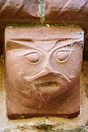 Norman Romanesque exterior corbel no 58 - sculpture of a stylised head of a human. The Norman Romanesque Church of St Mary and St David, Kilpeck Herefordshire, England. Built around 1140 .<br /> <br /> Visit our MEDIEVAL PHOTO COLLECTIONS for more   photos  to download or buy as prints https://funkystock.photoshelter.com/gallery-collection/Medieval-Middle-Ages-Historic-Places-Arcaeological-Sites-Pictures-Images-of/C0000B5ZA54_WD0s