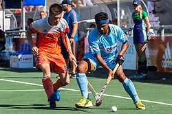 (L-R) Thierry Brinkman of The Netherlands, Birenda Lakra of India during the Champions Trophy match between the Netherlands and India on the fields of BH&BC Breda on June 30, 2018 in Breda, the Netherlands