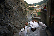 A man ties his turban after bathing in the pool at The Surya Mandir (known as the Monkey Temple), Jaipur, India