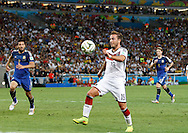 Germany's Mario Götze scores their first goal during the 2014 FIFA World Cup Final match at Maracana Stadium, Rio de Janeiro<br /> Picture by Andrew Tobin/Focus Images Ltd +44 7710 761829<br /> 13/07/2014
