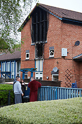 © Licensed to London News Pictures.  20/05/2013. MILTON KEYNES, UK. Residents wait to be allowed back into their homes after a fatal house fire in St Leger Court, Great Lindford, Milton Keynes. Police were called at 7.58pm last night (19/5) by Buckinghamshire Fire and Rescue Service to a fire at a residential address where an occupant died. A 57-year-old man has been arrested on suspicion of murder and remains in custody. Photo credit: Cliff Hide/LNP
