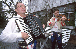 CZECH REPUBLIC MORAVIA BANOV APR98 - Jiri Chovanec (L) and his son Jan tune their instruments in their yard before setting off to play music in their village during traditional Easter celebrations. During Easter, folklore dress, music and mutual visits are part of the customary traditional celebrations in Moravia. jre/Photo by Jiri Rezac<br /> <br /> © Jiri Rezac 1998<br /> <br /> Tel:   +44 (0) 7050 110 417<br /> Email: info@jirirezac.com<br /> Web:   www.jirirezac.com