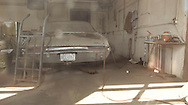Old Oldsmobile in abandoned garage on outskirts of Port Colborne, Ontario, Canada