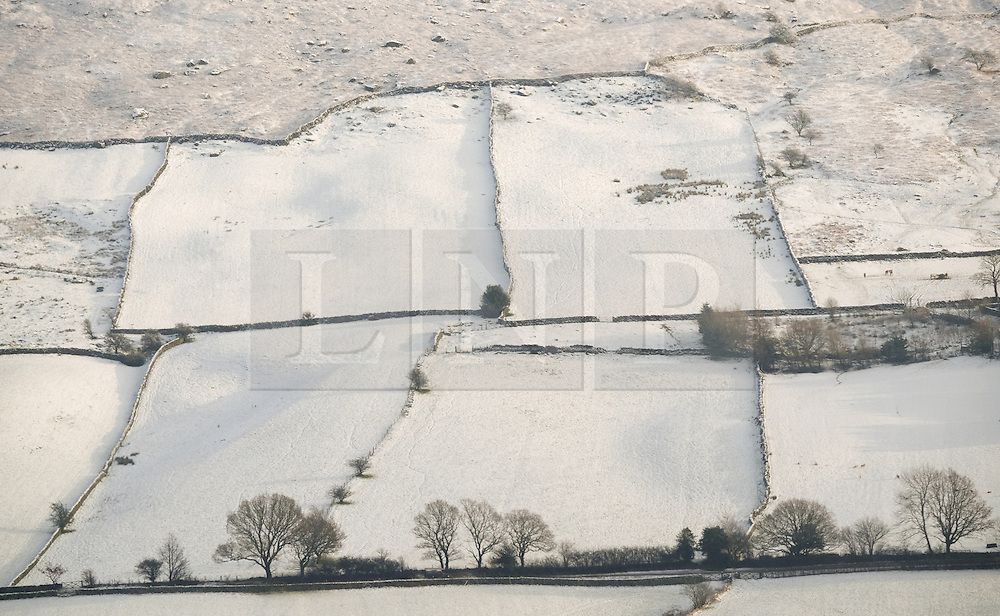 © Licensed to London News Pictures. <br /> 27/12/2014. <br /> <br /> Castleton, United Kingdom.<br /> <br /> Overnight snowfall covers the hills of the North Yorkshire Moors near Castleton.<br /> <br /> Photo credit : Ian Forsyth/LNP