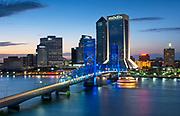 The blue colored Main Street Bridge crosses the Saint Johns River into downtown Jacksonville, Florida.