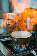 flambe cooking in a restaurant