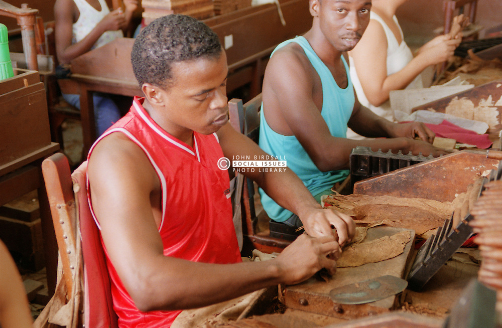 People making cigars at the Partagas cigar factory; Havana Cuba,