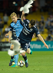 October 7, 2017 - Melbourne, Victoria, Australia - James Donachie (#17) of Melbourne Victory and Matt Simon (#18) of Sydney FC 1din action during the round 1 match between Melbourne Victory and Sydney FC at Etihad Stadium in Melbourne, Australia during the 2017/2018 Australian A-League season. (Credit Image: © Theo Karanikos via ZUMA Wire)
