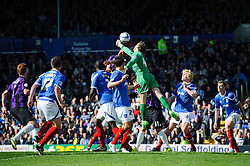 Danny East (ENG) of Portsmouth punvhes clear before Kaid Mohamed (WAL) of Bristol Rovers can heads the ball the ball - Photo mandatory by-line: Rogan Thomson/JMP - 07966 386802 - 19/04/2014 - SPORT - FOOTBALL - Fratton Park, Portsmouth - Portsmouth FC v Bristol Rovers - Sky Bet Football League 2.