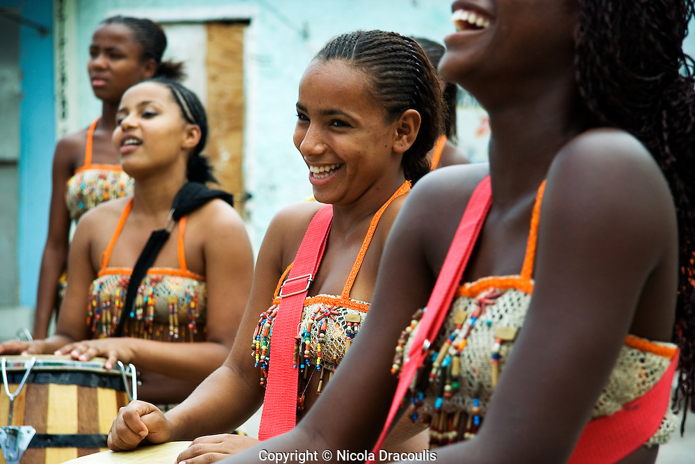 Akoni, the all-girl african drumming group performing in Vigario Geral. Rio de Janeiro, 2006.