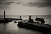 Entrance to Whitby Harbour on a dreary dull day.