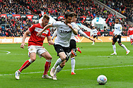 David Nugent (28) of Derby County battles for possession with Adam Webster (4) of Bristol City during the EFL Sky Bet Championship match between Bristol City and Derby County at Ashton Gate, Bristol, England on 27 April 2019.