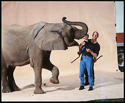 Morgan Howarth Feeding elephant with trainer on sweep Elephant