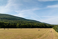 Cornwall, New York - Storm clouds over Schunnemunk Mountain in a view from Clove Brook Farm on July 13, 2018.