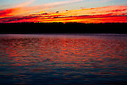 Sun setting over a Western Ontario lake in July. Also called the Laurentian Plateau, or Bouclier canadien (French) the Canadian Shield is a massive geological shield covered by a thin layer of soil that forms the nucleus of the North American or Laurentia craton.