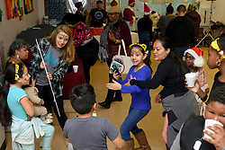 Families gather for the winter fest celebration at the Free Library branch in Olney, on December 16, 2018. (Bastiaan Slabbers for WHYY)