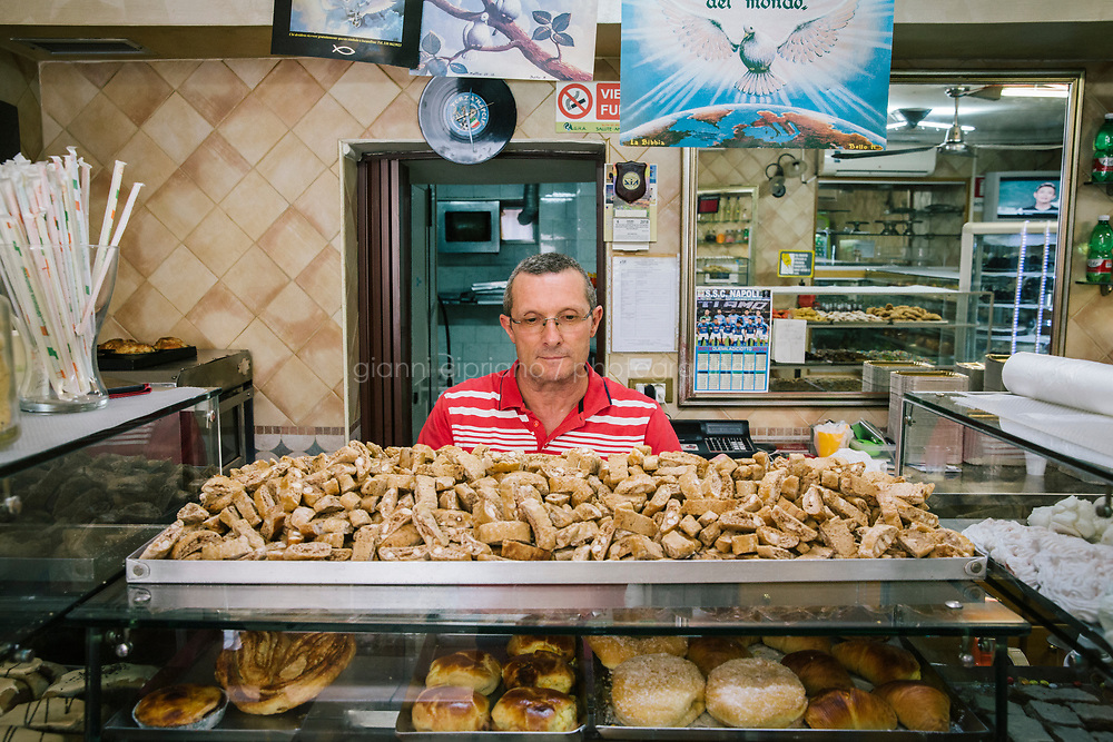 NAPLES, ITALY - 7 JUNE 2018: Vincenzo Sgambati is seen here behind quaresimale cookies made here at Pasticcielo, a bakery in Naples, Italy, on June 7th 2018.<br /> <br /> Pasticciello was founded 34 years ago by Lucia Tagliatela.