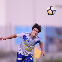 BRISBANE, AUSTRALIA - JANUARY 8: Jack Stevens of Strikers heads the ball during the Kappa Silver Boot Group A match between Brisbane Strikers and Eastern Suburbs on January 8, 2017 in Brisbane, Australia. (Photo by Patrick Kearney)