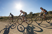 Ariane Kleinhans left) and Annika Langvad of team RECM 2 tuck in behind another rider to save energy during stage 5 of the 2014 Absa Cape Epic Mountain Bike stage race held from The Oak Estate in Greyton to Oak Valley Wine Estate in Elgin, South Africa on the 28 March 2014<br /> <br /> Photo by Greg Beadle/Cape Epic/SPORTZPICS