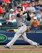 Shortstop Troy Tulowitzki #2 of the Colorado Rockies bats against the Atlanta Braves at Turner Field on May 24, 2014 in Atlanta, Georgia.