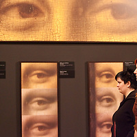 Visitors look at parts of the painting Monalisa on display during the opening of the exhibition to discover the artistic work of Leonardo Da Vinci, Budapest, Hungary. Thursday, 05. February 2009. ATTILA VOLGYI
