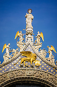 Gable detail and statue of St. Mark, Basilica San Marco (Saint Mark's Cathedral), Venice, Veneto, Italy